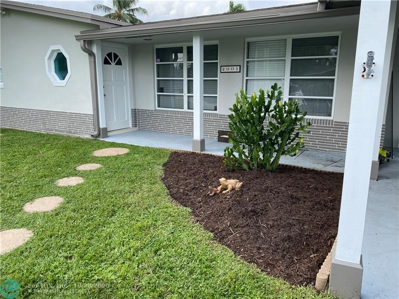 New On The Market, 2 bedroom 2 bathrooms, on the canal move in ready. This floor plan is spacious with a large patio off the living room and kitchen. Plenty of room for a pool, rv parking, etc. The location is conveniently located close to the freeway and the turn pike. 3 miles to the beach, 15 minutes from downtown Ft Lauderdale, yet Royal Palm is quite, peaceful place located in a waterfront community. There are parks, dog parks, lakes, canals creating the Sfla life style we all are looking for in a home. Some features are, new seawall,  upgraded hvac, fenced in backyard, tile floors, updated kitchen, and baths. This house is ready to become your next home. Easy to show.