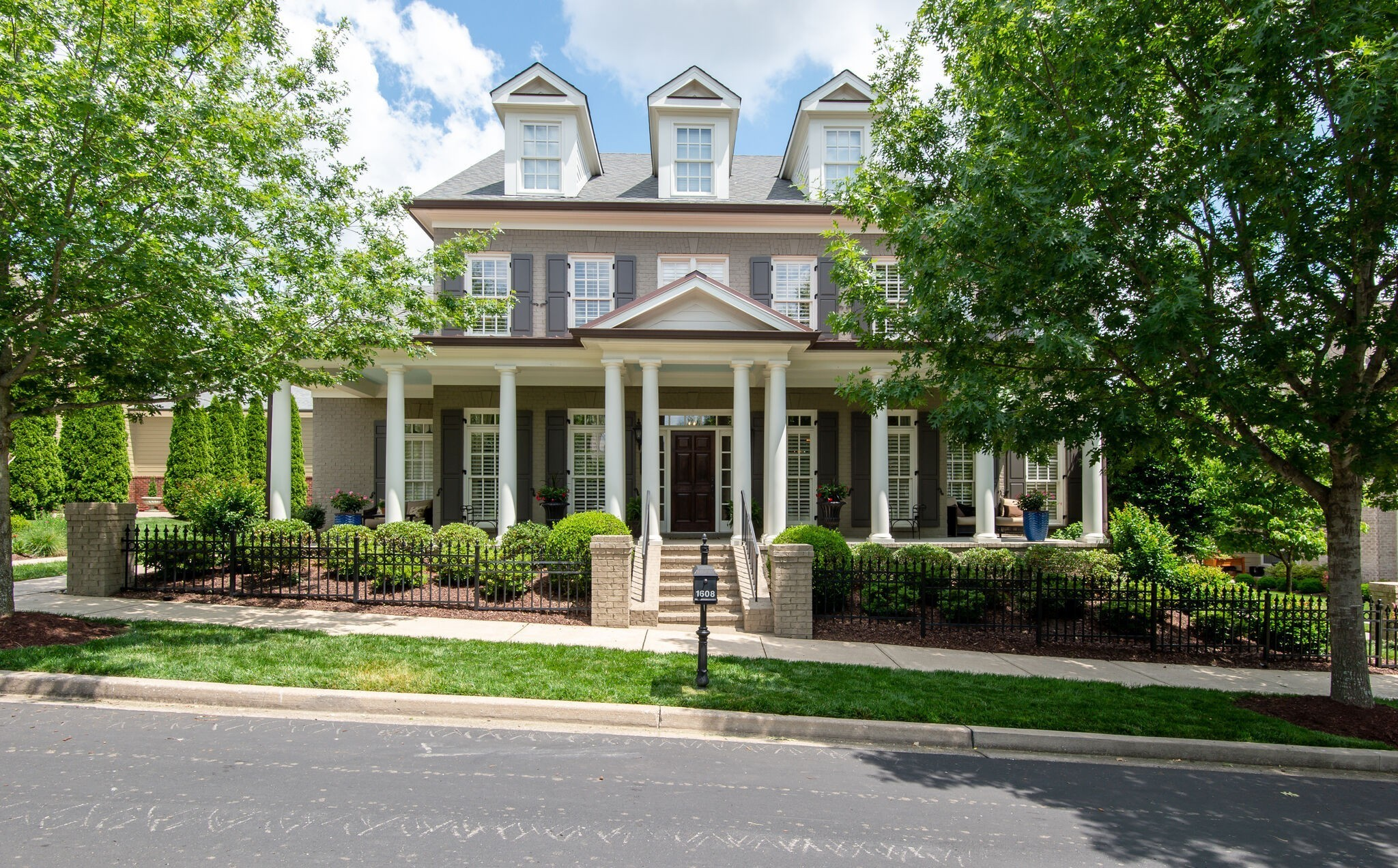 """Back on  the market Carlisle classic home! Crawl space encapsulation in progress! Well maintained,custom painted brick home-Carlisle.Southern front porch w/ 2020 roof and '16/'18 HVACS.Meticulously landscaped.Gleaming hardwoods most of main floor with fresh designer paint and master down.Chef's kitchen boasts walk in pantry,granite island w/new 36"""" 5 burner cook top /griddle.Hearth room off kitchen w/fireplace.Plantation shutters/wood blinds.Bonus room up w/ 3 beds,3 attics&large closets.."""
