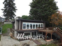American Lake Waterfront home and additional dwelling unit with western exposure towards Silcox Island. Main house features 3 bedrooms on two levels. Open floorplan is light and bright. Stainless appliances and gleaming hardwoods in upper living area. Efficient gas heat and double pane windows offer peace of mind. Fireplaces on each level for those chilly nights. Basement level features original paneling and bar for entertaining. Bulkheaded waterfront lot with dock for your boat and toys too!
