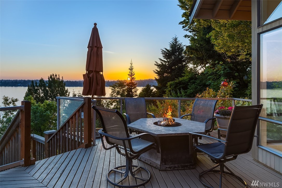 Panoramic views from Mt Rainier to the Olympics. 40' H2O with private pier. Sunsets year round. 4130 sqft 4 bedroom. Large main and lower level decks perfect for entertaining. Major update '06, new AC '16, new furnace and 2 HW '18. SW exposure for lots of natural lighting even during the dark winter months. Spacious entry level master suite+den , down to kitchen, nook, PR, living and dining rooms.  Lower level 3 bedrooms, a 3/4 BA and rec-room. Westside waterfront living!! A definite lifestyle!!