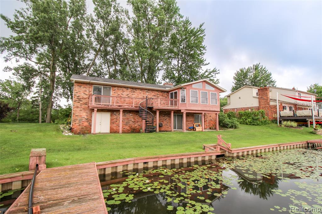 **OPEN HOUSE 7-25-21 ** 1-3pm** BRAND NEW furnace and A/C installed 7-7-21!! All-Sports Lake Fenton estate with over 2600 sq ft of living space and 100 ft of frontage on the channel! This all brick split-level has a fantastic layout with the upper level having 3 bedrooms, 2 full bathrooms, spacious kitchen, dining, and firelit living room. Plus a 4-season lake-view sunroom with double french doors! The lower level has an additional living/family room with wet bar, bedroom, full bath, and laundry room. The enormous 2 car garage has double doors out to the lake-side making it super convenient to store kayaks or other toys. The home comes equipped with 2 docks with room for your fishing boat, pontoon, or speedboat! Lake Fenton has room for them all! Seller is including a one year home warranty!