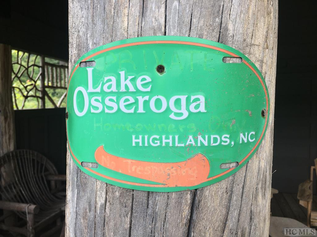 Lake Osseroga is a small gated lakefront community with its own pavilion with lake access and storage for canoes. The community is conveniently located between Cullasaja Club and Wildcat Cliffs. This lot is very close to the community lake and trail down to the boathouse. It is right across the street from the small pond. Your house site will see the small pond and waterfall.