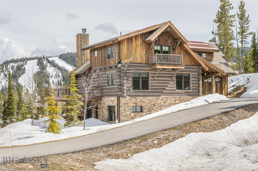 Ski-in, ski-out fractional for under $200K! 1/8th Fractional interest in a 5 bedroom, 4 bathroom Powder Ridge Cabin. Granite counter tops, a wolf range, wooden floors, a wraparound deck, hot tub, a gym and two living spaces!Enjoy six weeks on the slopes of Big Sky from this beautiful home.