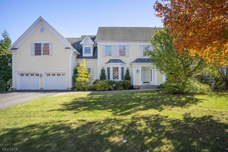 Meticulously maintained center hall Colonial located in coveted Chestnut Ridge section of Bernardsville.  Luxurious crafted wood molding throughout.  Spectacular 2 story foyer w/ gleaming HW floors. Bright & airy great room w/ expansive windows & wood burning fireplace opens to a large gourmet kitchen w/ huge center island, granite counter tops, SS appliances. French doors lead to a large deck great for entertaining.  1st floor office.  MBR suite boasts vaulted ceilings, a spacious bath w/Jacuzzi tub & 2 WICs.  Remaining 4 BRs are generously sized w/ a Jack & Jill bath & vast closet space.  Fully finished walk out lower level includes a rec room, leisure room & a full bath, perfect for entertaining.  Close to private/public schools, train station, downtown, major highways & shopping.  Move in Ready!