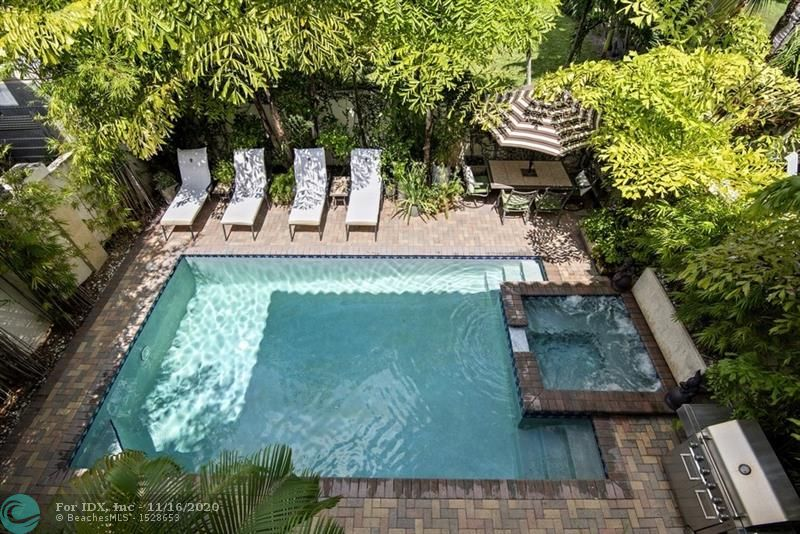 Many recent upgrades throughout in this gorgeous 3 bed 2.5 bath, 2,411 Sq Ft townhome with mature lush landscaping, koi pond, and salt water heated pool/jacuzzi. Solid cherry floors, Impact French doors and windows, and crown moldings! Beautiful custom kitchen with granite counters and separate eat in breakfast area. Living/dining with French doors to pool and patio area for entertaining. Upstairs is sumptuous oversized master suite, bath with dual sinks, brand new oversized spa type shower, dual shower head/sprayer and 4 body jets for a zen like experience. Private covered balcony off Master. Spacious 2nd bed with private balcony. Jack & Jill bath and 3rd bedroom.  New Salt Water Pool Pump. 2 AC's in 2017, oversized two car garage, central vacuum.  One block from Wilton Drive. Enjoy Life!