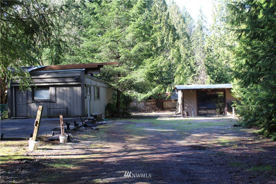 """Opportunity abound near Ames Lake.  Teardown on a level 9500 square foot lot with 24x40 garage.  Beach rights included.  This is a """"cash only"""" sale.  Water, power even a slab in place but no septic.  Drop a manufactured home (buyer to verify) on the lot and its an amazing affordable home."""