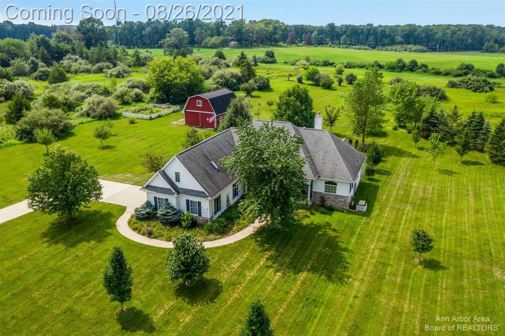 A rare opportunity to own a custom built ranch on a park-like 5+ acre lot in Pinckney's Hearthside Estates! This home offers a stylish & comfortable floorplan. Enter to a bright & airy great room w/vaulted ceiling. Large windows flood the space w/light & beautiful hardwood flows into the formal dining room. The custom kitchen comes complete w/granite tops & ample storage. French doors off the breakfast nook lead to a sunny 3 seasons room. The master suite features 2 walk-in closets, bay window & private bath w/jetted tub. Two additional bedrooms share a full bath. A double sided fireplace warms the great room & master. Laundry is on the main floor too! And if you need more space, you'll find it in the 26x16 bonus room. Perfect for a 4th bedroom, playroom or home office. Outside, a hot tub awaits on the spacious deck. All situated in the heart of the private back yard that's filled w/trees including apple, peach, pear & plum! There's also a HUGE pole barn w/loft, garden space & fenced a