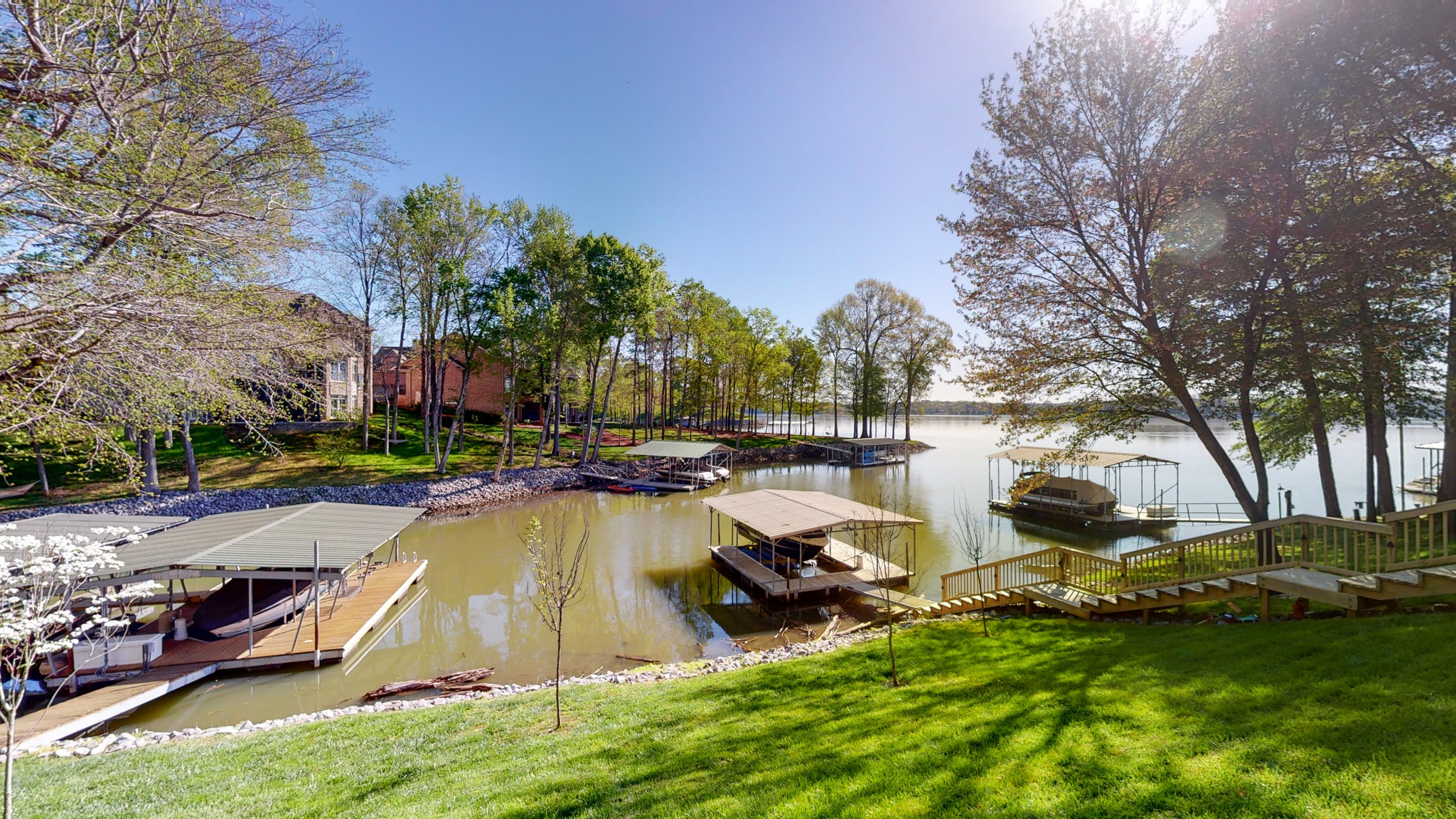 Unbelievable views from your new home on the lake. Highly coveted private boathouse on Old Hickory Lake, over 5,000 sqft of living space, fireplaces, finished basement, Florida room, and panoramic lake views from much of the house. 6,600 lb HydroHoist lift.