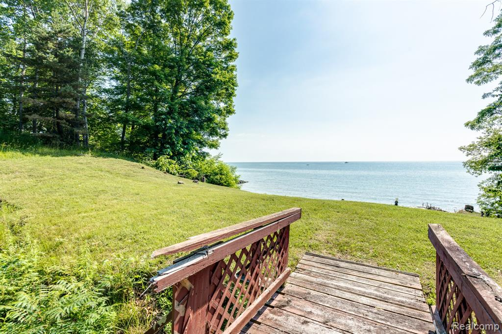 180 FEET OF LAKE HURON FRONTAGE IN THE VILLAGE OF LEXINGTON!!! This property is a rare find featuring access to city water/sewer, natural gas, 180 ft of sandy beach with 3.8 acres of land. Walking distance to the center of downtowns shops, bars, restaurant, theater, the historic Cadillac House/Carriage House and much more.  The potential for this property is not limited to one new build home, pending zoning approval a housing development (cluster) could be a great investment opportunity. The exterior of the 2880 sq. ft. home is in good shape, it just needs your touches inside. Truly a beautiful piece of property with endless potential on the shores of Lake Huron.