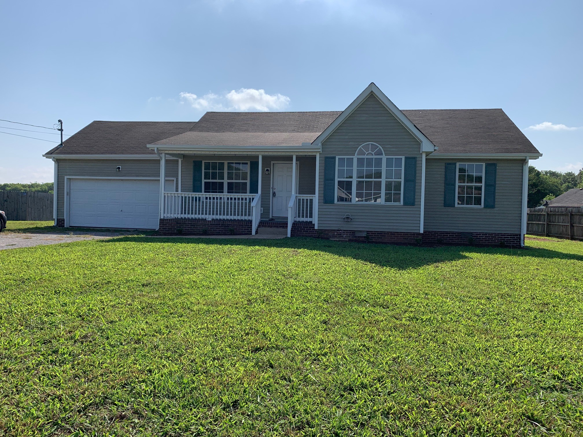 NEW FLOORING - FRESH PAINT - HIGH SOARING CEILING IN THE LIVING ROOM - REFINISHED CABINETS - TILE BACK SPLASH - NEW LIGHTING FIXTURES - TREY CEILING IN MASTER BEDROOM - DOUBLE CLOSETS IN MASTER BEDROOM - 2 CAR GARAGE - BACK DECK FOR GRILL OUTS - SPACIOUS BACK YARD -