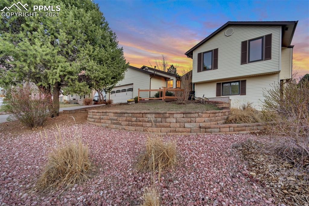 Location, Location, Location! Easy access to I-25, shopping, hiking, dining, hospitals and parks.  This home boasts of fantastic views from your living room and deck, large lot, quiet neighborhood and mature trees. The family room window looks out on Pikes Peak & the Front Range!!  A private master bedroom area upstairs, two large bedrooms downstairs, with their own bathroom. An over-sized garage with plenty of storage space, as well as an epoxy floor, for easy cleaning and a fresh look. Enjoy the deer that stroll the neighborhood and all this wonderful home has to offer! Be sure and take the walk-through tour at https://my.matterport.com/show/?m=8u1eBiEKtm3.