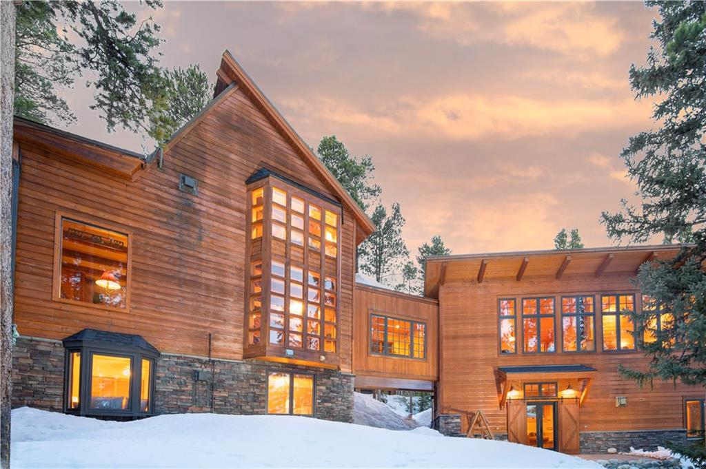 "This re-imagined ""cabin in the woods"" has amazing craftsmanship in the new addition with new master bedroom/bath & cool bar/rec room.  The exterior boasts traditional mountain home with a mountain modern touch.  The home is nestled in the woods, with decks galore to enjoy the outdoors.  The custom wooden spiral staircase, shows the incredible craftsmanship of this home.  You are minutes to incredible hiking with wildlife surrounding you and a short drive to skiing or the town of Breckenridge."
