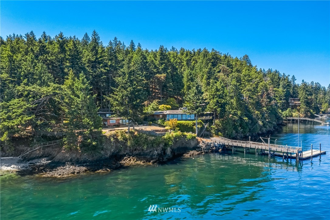 Exquisitely sited overlooking Speiden Channel in the Gull Cove community with end of road privacy. This distinctive, timeless, truly quintessential island estate offers 3.5+/- acres in 2 waterfront parcels with walkway to 435' of waterfront inclusive of great sandy beach and 120' pier with private deep-water dock and dinghy lift. The regionally inspired single level 3778 sf home celebrates local color and opens out to the sea boasting warm and lofty interior spaces, and refined finishes with 3 bed/4 bath flowing gracefully to outdoor areas with fenced garden. Outbuildings include 1392 sf waterfront guest cottage with 3 bed/2 bath, 576 sf office/studio, shop - multiple garages. A sophisticated, yet casual relaxing retreat. Simply dreamy.