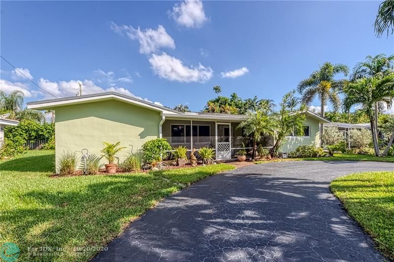 Wonderful East Wilton Manors neighborhood (and neighbors!) -- make this 3 bedroom, 2 bath, pool home yours!  House protected by all impact windows & doors.  New A/C system in 2019 with NEST thermostat.  Kitchen has granite counters.  Lots of nice features here:  circular driveway with ample parking, front porch, indoor laundry room, large storage room (former garage space), lots of closets, new gutters, useful shed.  Generous screened porch overlooks the pool & yard.....very relaxing setting.  House tented end of September 2020, covered under a termite warranty which is transferable to the new owner.  A short 8 minute drive (2.6 miles) to Fort Lauderdale Beach.  Just a few blocks to the new Starbucks, close to Stork's Bakery, and approximately half a mile to 5 Points  Publix, CVS, & more.