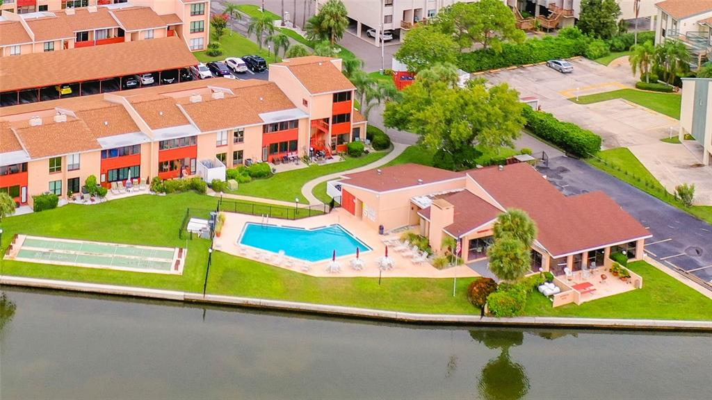 """Waterfront community on the Intracoastal Waterway, and a short walk to Indian Rocks Beach. This condo has 2 Bedrooms and 2 full Bathrooms, plus an enclosed porch with storage and a carport.  The community pool is right next to the water where you'll enjoy watching the dolphins playing and the boats passing by. You will be walking distance to the Award Winning Gulf Beaches, the Trolley, and many Restaurants & Bars. This unit comes with newer appliances in the kitchen, and has a washer/dryer unit as well. Some updating is needed and this is reflected in the low list price.  Put your personal touches on this """"Diamond in the Rough"""" and you'll have a perfect vacation home or income producing property. Roofs replaced in 2020, and kitchen appliances are 2-6 years new."""