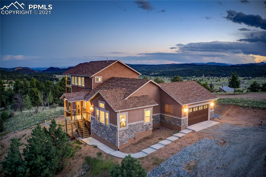Welcome to this hidden gem nestled in the heart of a small and quiet Colorado mountain town. The moment you step inside, you will be blown away by the unbelievable views and impressive finishes. The open floor plan is perfect for entertaining. The comfortable living room encompasses a custom floor-to-ceiling gas fireplace and plenty of space to relax. Enter the kitchen showcased by its spectacular size and gorgeous features. The counter bar with waterfall edge quartz counters, Samsung stainless steel appliances, and abundant soft-closing cabinets and drawers decorate the gourmet kitchen. The informal dining space offers a private walkout to one of three decks. Two bedrooms, including the master retreat reside on the main level. Experience instant comfort as you enter the master suite flaunting a barn door revealing a spa-like en suite defined by separate double vanities with quartz counters, soaking tub, walk-in closet, and a walk-in shower with wall mounted and waterfall shower heads.  The upper level houses two bedrooms, each with a walk-in closet and a walkout to the wrap around covered deck overlooking the breathtaking mountain surroundings. The spacious upper level family room offers a walkout and is plumbed for a wet bar. The unfinished basement provides the perfect opportunity to create your own personalized space! The exterior of the home offers three separate decks to relax and enjoy the peaceful sounds of Mother Nature. Colorado Mountain Estates is a covenanted and architecturally controlled community with about 2,000 acres, backs up to Mueller State Park, and is home of the Florissant National Fossil Beds. Enjoy wondrous fishing, hiking, and camping opportunities in the area. The home is also 20 minutes from the historic gambling town of Cripple Creek which offers unique events such as the Annual Donkey Derby Days, Ice Festival, and the Annual Salute to American Veterans Rally. Come embrace Colorado Mountain Living at its finest in this remarkable home!
