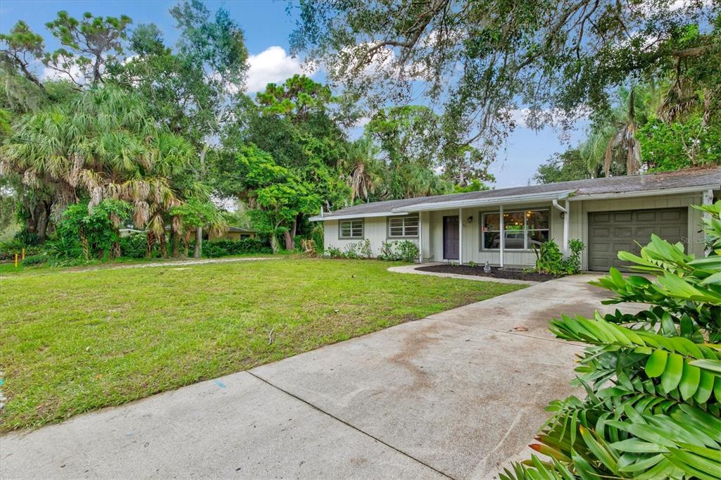 Come see this beautiful 3 bedroom, 2 bathroom home on large lot with garage and large backyard located in the heart of Sarasota. Home has wood flooring throughout the main living area and kitchen. Carpet in the bedrooms and tile in the bonus room. Enjoy the beautiful mature landscaping outside on the large covered patio. Plenty of space to park your boat or RV and to build the pool you've always dreamed of. Great location close to schools, shopping, dining, UTC Mall and much, much more! Sold as is with right to inspect.