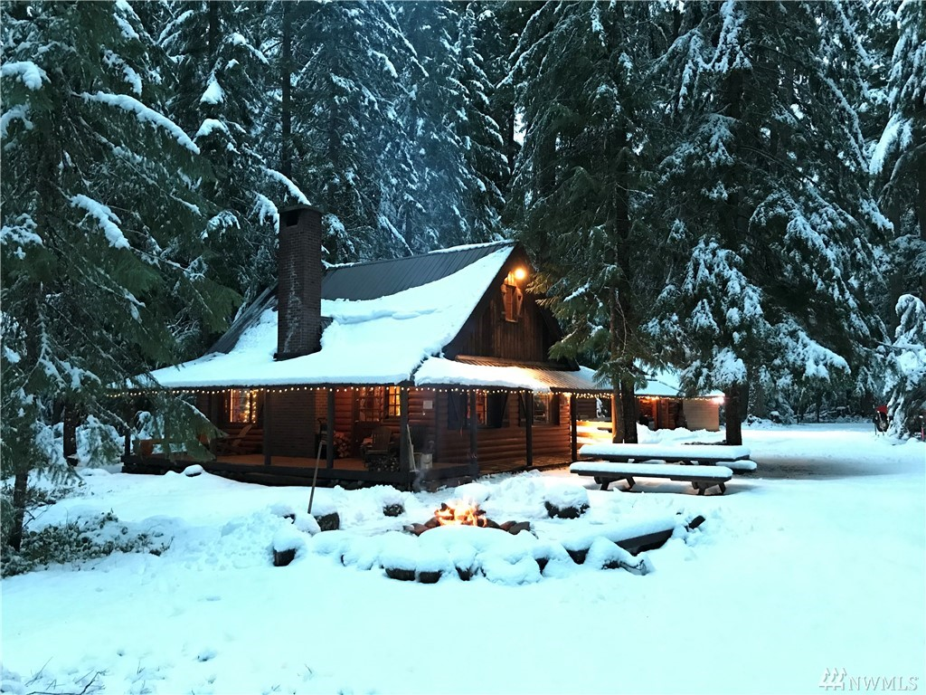 Awesome location for easy access to mountain adventures. Cabin on USFS land just 6 miles to Crystal Mtn Resort. Gather friends in the huge great room around the custom river rock fireplace. Wood interior, vaulted ceilings, log staircase. 3 lofted sleeping areas. Easily sleeps 12+. Kitchen w/dining. W/D in Bath. Generator wired, security system, on-demand hot h2o, metal roof. Water & septic. Covered porch & walkways. Woodshed/shop. Campfire ring. Walk to Mt Rainier & Silver Springs forest trails.