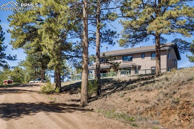 Welcome home to this luxurious property tucked away in the mountains that is only 25 min to Woodland Park. The main house was built entirely with masonry blocks and bricks and features a metal roof. The cathedral ceiling and wood beams really look spectacular. The grand staircase is made of poured concrete and the safe room is built underneath the stairs with a 5 hours fire resistant steel door. The cozy wood-burning fireplace heats the entire house and keeps you nice and warm during winter time.