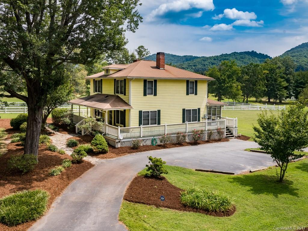 Build equity and enjoy privacy. Incredible opportunity in the beautiful Cane Creek valley. Great location - less than 20 minutes to downtown Asheville. Come take advantage of the mountain view from 38+ acres of level land that borders babbling Cane Creek. 1925 farmhouse ready for your style. This property offers spectacular views, gentle terrain, woodlands, pastures, and private creek frontage. Ideal for horse lovers with limitless possibilities. Come make many dreams come true: private estate, horse farm, cattle, gardening, orchard, farmland, pasture/grazing, residential, second mountain home, or recreational. You choose, decide, and enjoy. Additional building sites for expansion possibilities, great for a family retreat! 7,000 SF 6-stall octagonal barn with water, power, tack room, office, bath, & viewing platform/storage area. Professionally installed riding ring with lights. Fenced pasture, & 3/4 stall barn. 45 minutes to Tryon International Equestrian Center. Trails nearby.