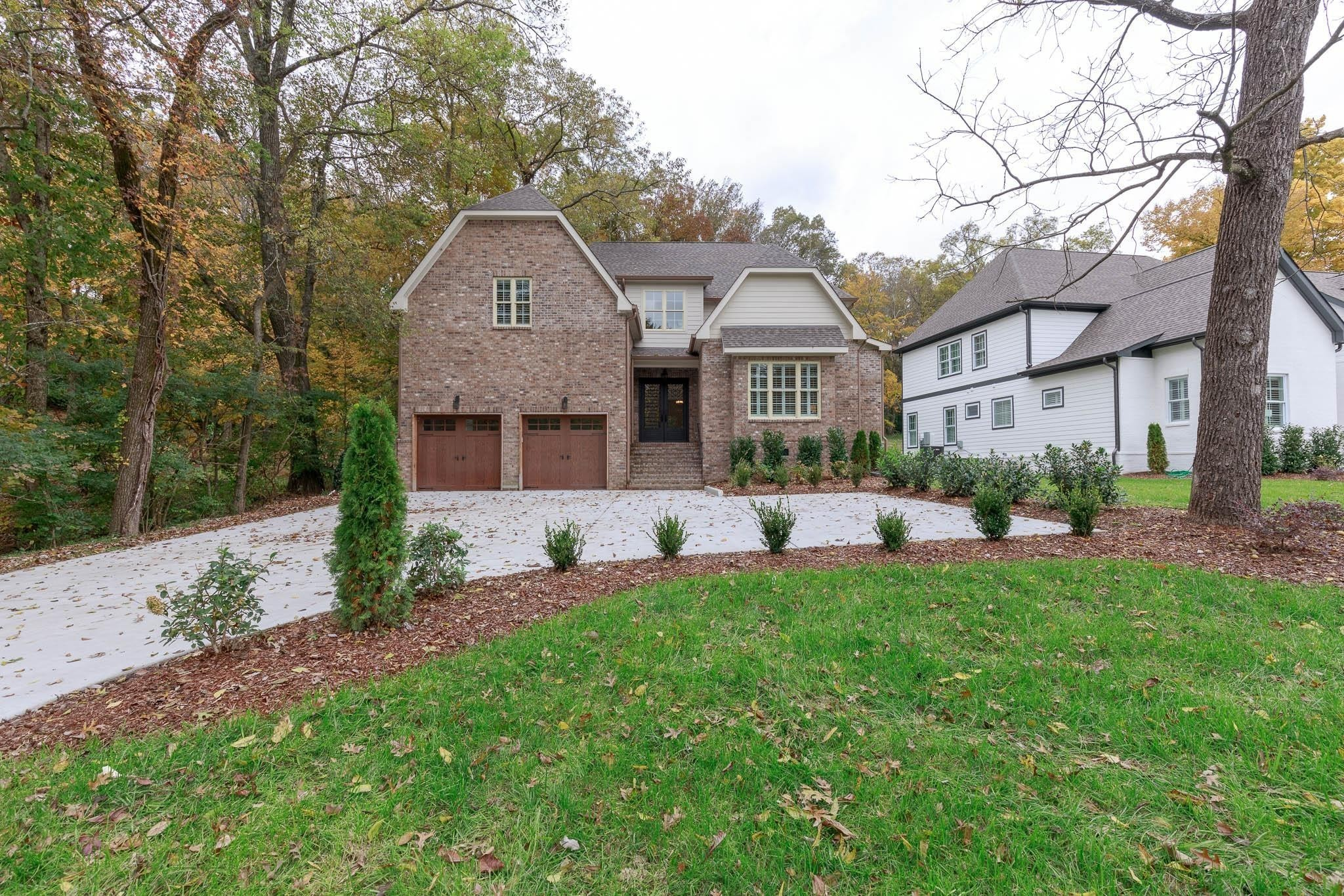This modern home will delight you with an open floor plan and all the modern updates such as granite, hardwood, custom closets, recessed lighting and every square inch beautifully designed! Screened back porch overlooking wooded back yard!