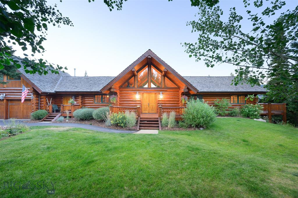 Situated on just over three private and picturesque woodland acres with breathtaking mountain views in Spanish Peaks North, this is a home you'll want to call your own. The house is constructed of massive Western Red Cedar logs and has warm rustic finishes with modern conveniences. The kitchen is open, elegant, modern, and functional and opens to a dining room with a view. The main level master is spacious and warm and has drop-dead views over the main rear deck to the Spanish Peaks. The master bath is roomy and luxurious with a large travertine shower, oversized soaking tub, and its own private balcony. Downstairs are three roomy bedrooms, 3bathrooms, a cozy family room/billiard/game room. The house is sold fully furnished with a few exceptions. The quiet and peaceful mountain setting will seduce you. Abundant wildlife frequents the homesite and the Alpenglow on the Spanish Peaks is magical. Call your real estate professional of choice to arrange a tour of this amazing mountain home.