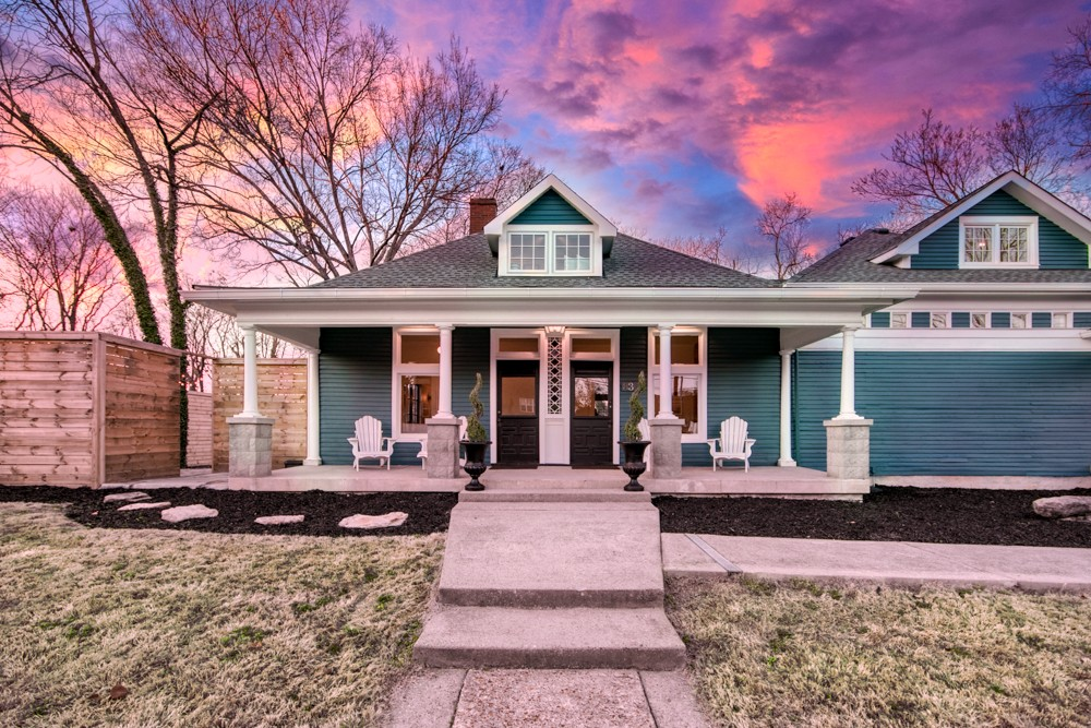 Fully restored historic home w/ original character in mind. Incl. period heart pine floors, pocket doors, exposed beams, 12' ceilings. Commercial grade kitchen w/ oversized island, 30's style bar, restored fireplace, exposed beams, HUGE great room with 20' ceilings and 15' windows wired for surround sound. In-law suite, home theater, 3 recording rooms, premium finishes. Ideal for living & entertaining in heart of 12South.
