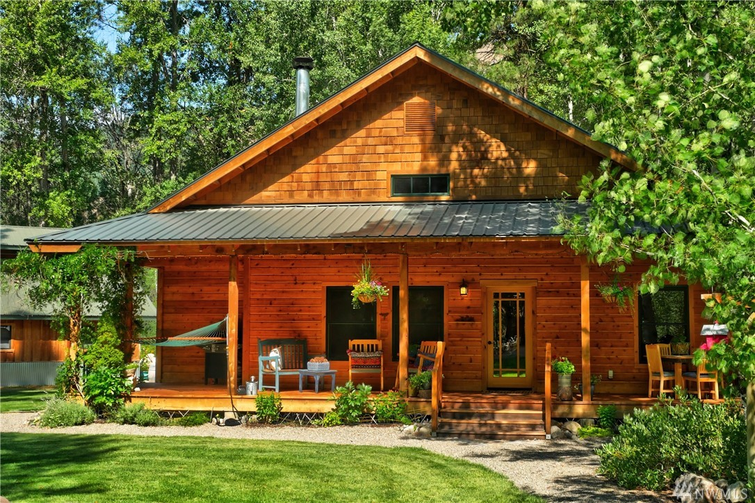Charming 2 bedroom, 1.5 bath, cabin, with wrap around decks. This 2.5 acre paradise includes 1/2 interest in an amazing 15 acre riverfront sanctuary with 400+ ft of low bank riverfront. Watch salmon spawn, listen to the quaking aspen or explore nearby swimming hole! Large 1600' shop/carport/barn with heated storage space, guest cottage for visitors, garden area, and hen house make this a rare gem in the Methow Valley. Wired for backup generator (included).