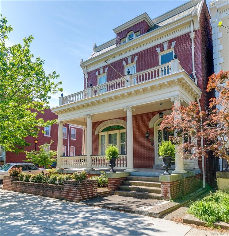 This is your opportunity to own a unique home in the historic Fan District in Richmond. 2701 Hanover Avenue was commissioned by an Irish distiller, who also repaired and built carriages in the lower level. Designed in the newly fashionable Colonial Revival style, it was characterized by the use of classical columns, cornices, leaded-glass fanlights and sidelights, while its updated amenities make it ideal for modern living. The system are all quite functional and in great working condition. The upper level has a master suite with luxury bath and three other bedroom, plus a nursery/office and a grand family bath. The main floor is both formal and casual with a modern kitchen/family room combination. The lower level (basement) offers total living of its own. Outside there is both outdoor and indoor private parking, a closed-in wood desk and courtyard/patio.
