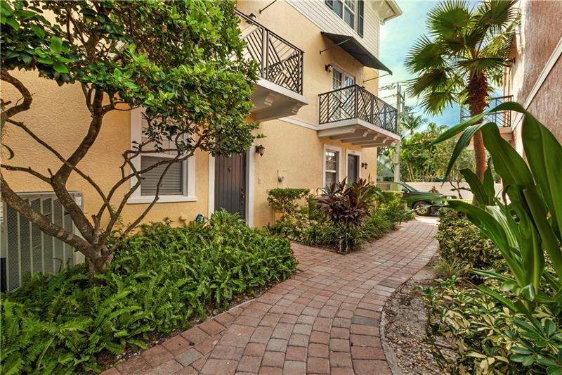 Urban Wilton Manors Townhome walking distance to restaurants, shopping, galleries, fitness centers, nightlife and more. Welcome home to Belle Isle townhomes, this unit overlooks a tropical courtyard and fountain and is only steps to from the community pool. This is a pet friendly community allowing up to 3 pets. This bright open floor plan is designed as a 2 bedroom, 3.5 bathroom, 1st floor bonus room and 2-car garage. The gourmet kitchen overlooks the great room with French doors opening to a balcony, while intimate meals can be had in the formal dining room. The master suite is generous in size and boasts a walk-in closet & W/D on the same floor for convenience. Impact windows and doors and central vacuum. Square footage from IMAPP.