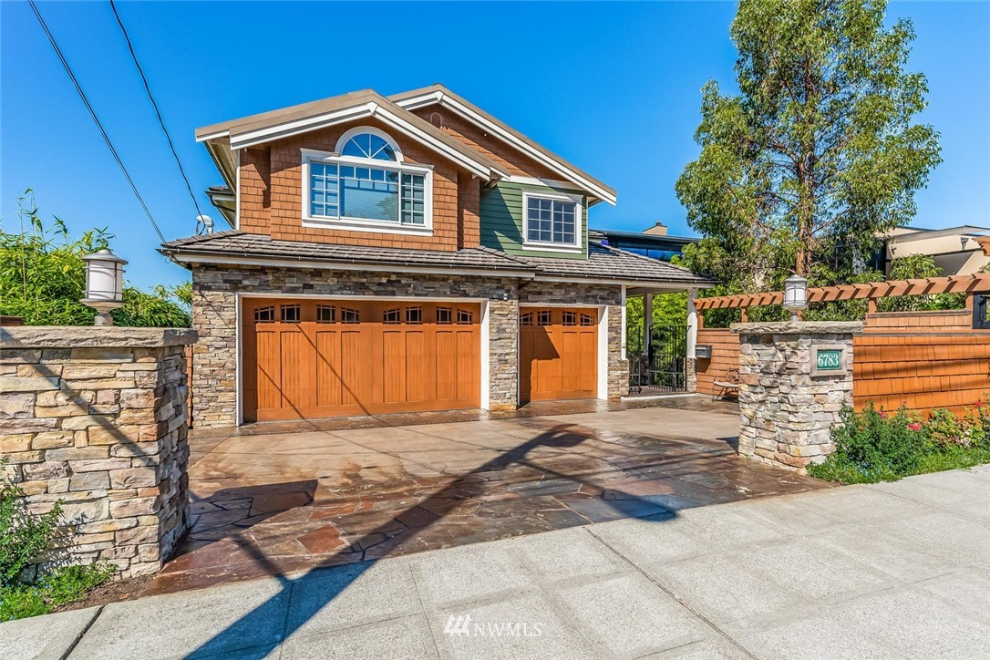 Stunning 2005 custom-built home. Inlayed stone driveway, copper gutters & concrete tile roof show attention to detail. Home has 5,500 SF, 4 beds, 3.5 baths, 3 car garage, gourmet kitchen w/Wolf range, custom theater room, elevator, office, plus 50' of waterfront & world class sunset views. Master BA with steam shower & sauna room. Gas generator ready to go. Dog room w/wash tub and access to outdoor run. Attached & detached ADUs. Steps to Lincoln Park & Loman Beach. Meticulously maintained!
