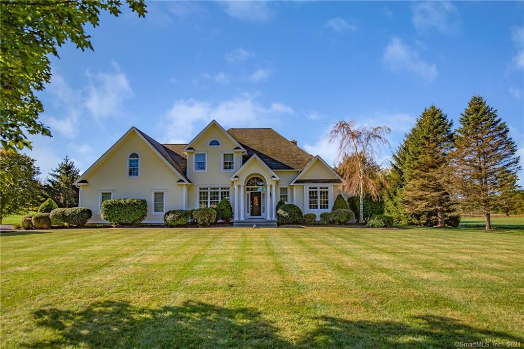 Stunning, custom built Colonial situated on a double lot on Halladay Ave in Suffield with a first floor master bedroom suite. This one has it all. Open concept living with a cathedral ceiling great room, beautiful fireplace and large palladian style windows. Gorgeous eat-in kitchen with custom cabinets, granite countertops, Viking range and Sub-Zero refrigerator. The first floor master bedroom has a tray ceiling, large walk-in closet, and a stunning master bath with a soaking tub and walk-in granite tile shower. Incredible woodworking and details are found throughout the house including beautiful white wainscoting, cove molding trim, and a Brazilian cherry handrail on the staircase and upstairs balcony. Upstairs features two more large bedrooms, another full bath and a fantastic 600ft bonus room. Downstairs you'll find a full basement with a hatchway, coal stove, and plenty of storage or finishing potential. Buderus hydro air heating system with domestic hot water system, central air, central vacuum, and twin 330 gallon oil tanks. Two car attached garage and a beautiful, Barn Yard outbuilding. Great backyard patio and fire pit along with plenty of garden areas with mature plantings. This incredible home sits on 2.12 stunning acres with the possibility of being subdivided or just enjoy the extra acreage to yourself!