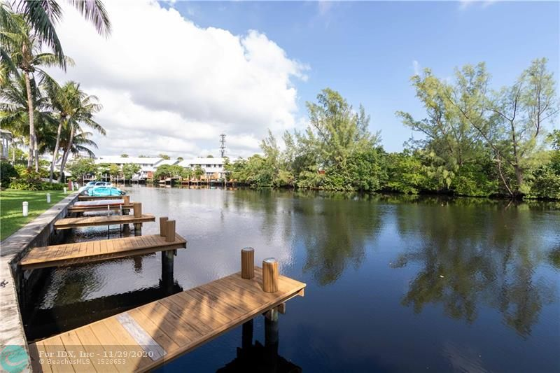 This Tropical waterfront townhome is located in an intimate 15 unit complex on the Middle River. You have your own deeded 12ft dock perfect for a zodiac,Kayak,paddle boards, small boats. Ocean access with fixed bridges. Minutes to Wilton Drive and close to Whole Foods, Publix, and Fantastic restaurants and night life. Impact doors and windows offer water views from the living room and masterbedroom balcony. Dockside Village offers a pet friendly, key west  complex with roof repairs,and the exterior insurance incl in your maintenance. Amenities of a heated pool,patio and gazebo on the River. There are two master suites and laundry on the 2nd floor. This Townhome comes with a covered parking space, and plenty of parking. Pets Welcome!!See attachements for application, hoa docs and amendments