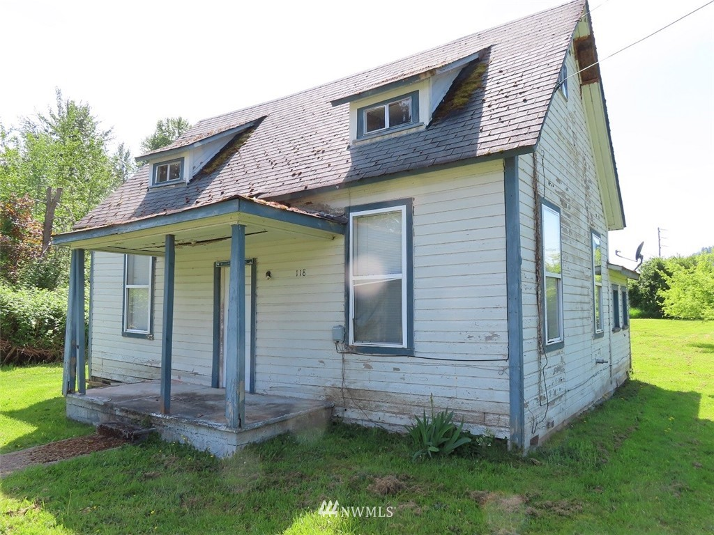 """Fixer House in Randle WA on a very nice level shy ½ acre lot. Great project for the do it yourself-er and would make a great rental or home based small business once it is restored or re-built. The house is serviced by Randle public water and is on septic. The house is not in loan-able condition, cash offers only.  Property is zoned STMU """"small town mixed use"""" House is not livable, this is a project."""