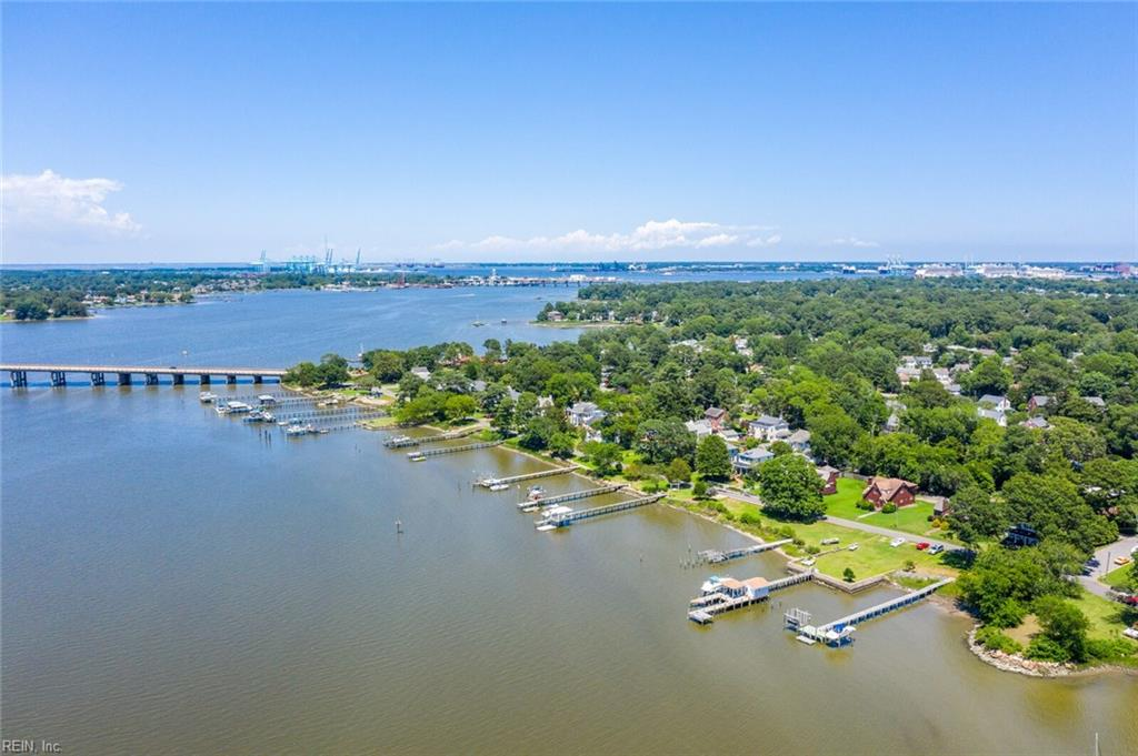 Live the life you've always dreamed of!  Completely renovated waterfront home with expansive views and deep water access to the Elizabeth River.  Your own private pier includes custom floating dock, 10,000 lb boat lift and large pergola to sit & enjoy year-round stunning sunsets. 15 minutes to the Chesapeake Bay by boat.  This classic colonial revival has been meticulously and uniquely renovated using all custom high-end quality finishes while maintaining its historic warmth & charm.  Huge front porch to relax & enjoy the breeze.  First floor master suite with spa inspired bath .  Over 500 sq. ft. second floor studio with bath & private deck is perfect for guest, in-law suite or young adult to have their own space.  The gorgeous sun room overlooks lush landscaping.  Completely updated kitchen. Beautiful hardwood floors throughout.  A complete detailed list of the fine features is available.  Call for an appointment today.  You deserve it .