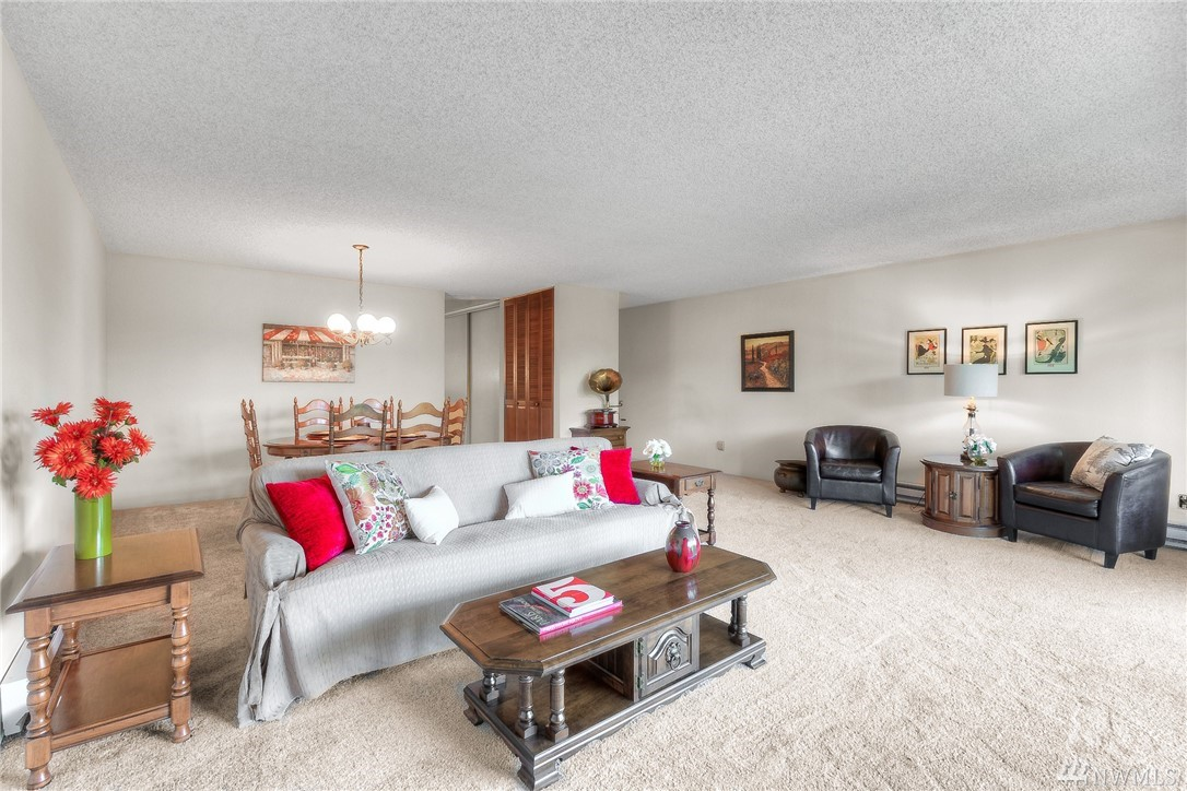 Rare opportunity in fantastic location! Spacious 2bd/2ba condo in the heart of downtown Mercer Island! Across the street from the new Metropolitan Market, close to coffee, shops, park&ride. Large private balcony overlooking park-like setting and outdoor pool area. Large master bedroom with lots of natural light and huge closets. 2nd bedroom has extra space for office.  Open-plan great room feel for living room and dining areas. Dedicated parking. Expansive trails just across the street.