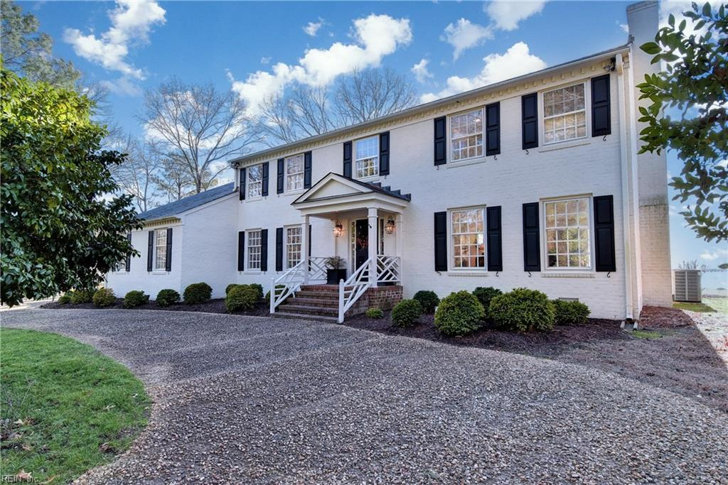 Opportunity for 200' water frontage on the James River...2 parcels being sold together for a total of approx. 1.7 acres! Exhilarating views of the historic James from the high lot in the heart of Riverside.  Traditional architecture blends seamlessly with an open, 2-story expansion joining the kitchen, dining, and great room areas. Kitchen features custom cherry cabinets, handsome tile floor, Subzero refrigerator, double ovens, well configured counter space, and stunning views. Formal rooms with lovely moldings, den with wet bar and beamed ceiling, hardwood floors, ample pantry and storage space. Floored attic with cedar closet for additional storage.  2nd staircase from great room leads to a light-filled sitting area and billiard room.  Large brick patio for outdoor grilling, dining, and entertaining...overlooks the pier with covered dock. Bulkhead is concrete reinforced with granite. Security and irrigation system.