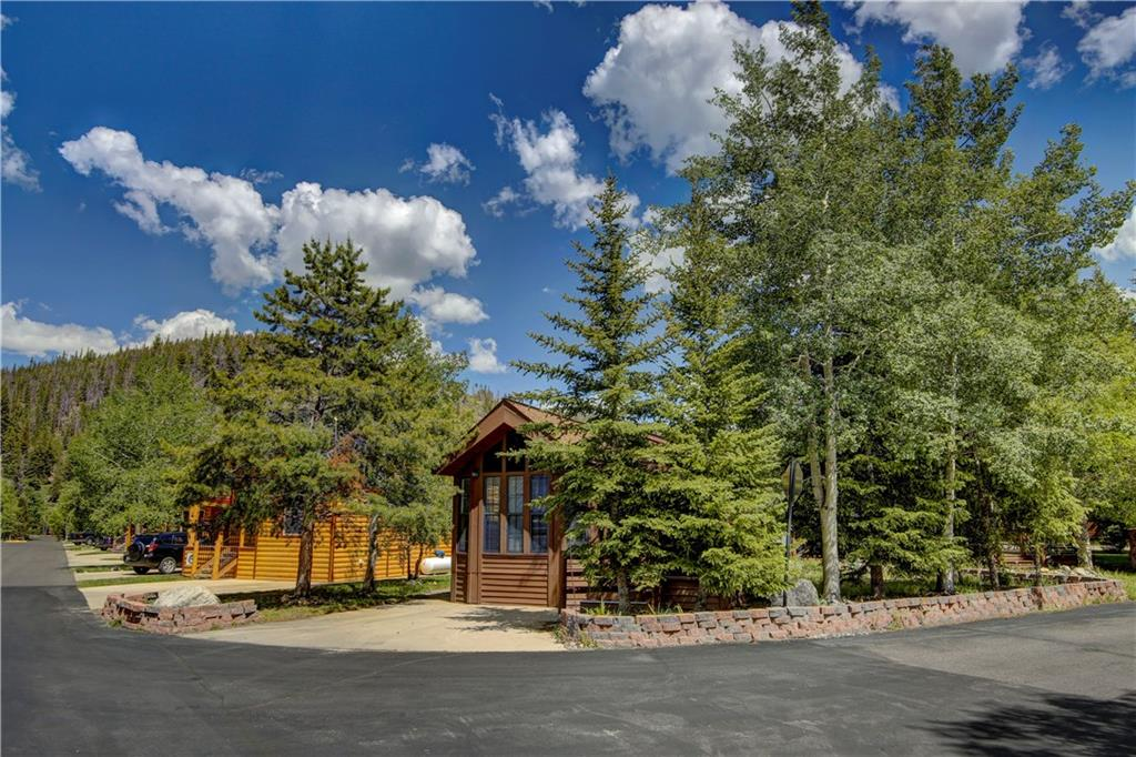 This one bedroom, one bath, plus loft chalet that was built in 1999.  It features a beautifully treed large corner lot with amazing views to the Ten Mile Range, located across from the Clubhouse and all of the resort's amenities!