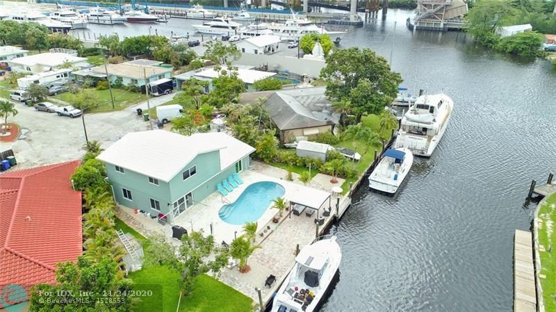 BRING YOUR YACHT! Perfect large yacht basin with turn around. Rare point lot with 114 foot deep water dock space. Can accommodate multiple boats. Large concrete dock and seawall. Power hookup to dock. No fixed bridges. Brand new marina only one minute from home. Can service big yacht. Close to downtown Fort Lauderdale and beaches. Stunning two story three bedroom three bath home remodeled and move-in ready. Brand new furniture negotiable. Beautiful porcelain flooring on first floor and PVC laminate flooring on second floor. Pool has been redone completely, new diamond blue textured, new special travertine all around and new salt water chlorinated system. Come see this beautiful home!