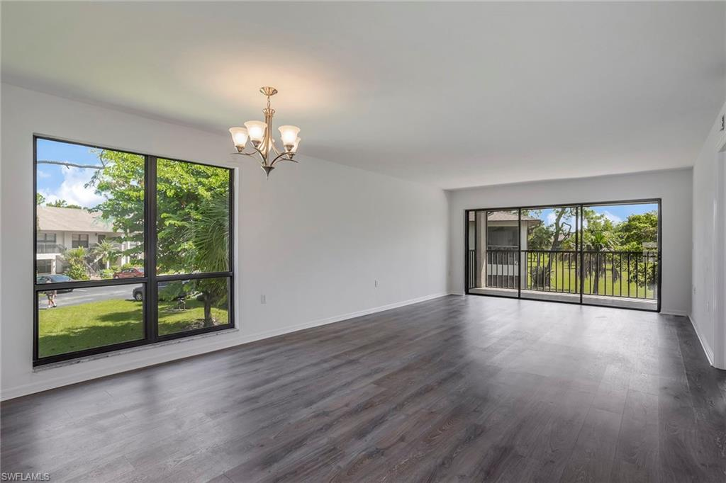 Great corner unit with an abundance of natural light. New flooring and fresh paint. The unit overlooks a large community Green space that houses two pools and is quite private. Plenty of guest parking located directly across from the unit and is a rare find in The Abbey. Ideal for those that entertain.  Unit offers a full eat-in kitchen, over sized lanai and very large walk-in closet in master bedroom.  With the low quarterly fees, the Abby at Berkshire Village is tremendous value in Naples.