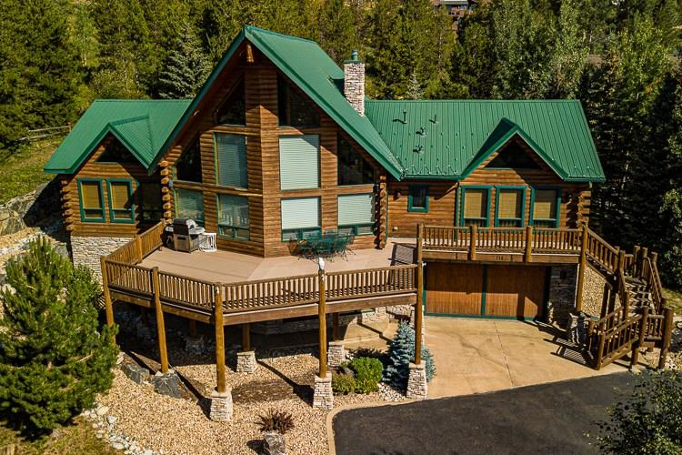 This luxurious mountain log home in the heart of Dillon is walking distance to everything! The home consists of 5 BR and 5 BA + loft and has 4,987 square feet of living space. Fantastic finishes adorn this log home including slate flooring, solid knotty alder doors, granite slab counter tops throughout and comes fully furnished with high-end log home furnishings. You will love the vaulted ceilings on the main level and the views of Keystone Ski area and Lake Dillon. Within 30 min of 5 ski areas!