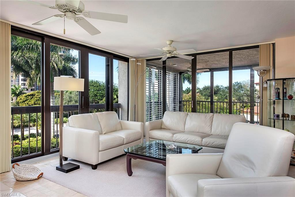 This sparkling clean condominium showcases a bright living room and dining area with a desirable enclosed lanai, two split bedrooms with two baths and is ready to be enjoyed for the season. It is move-in ready with furnishings being negotiable and has the added protection of hurricane-rated glass throughout. Beautiful Chateaumere sits on 10 acres, with three pools, a spa, two guest suites, an exercise room, an excellent on-site manager, friendly people, securely locked lobbies and recent recipient of the prestigious Sand Dollar Award for best design of the newly renovated lobby and social room in the high rise. Ideally located very close to the trams to whisk you down to the private Pelican Bay restaurants overlooking the ocean or to start your day right on the white sandy beach where attendants will set up chairs and an umbrella. Enjoy the Naples lifestyle in a gorgeous setting, perfectly located very close to fabulous shopping, more delicious dining options and Artis—Naples.
