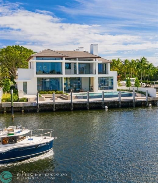 Most recently completed new construction in Harbor Beach! Beautifully refined Coastal Modern design by Randy Stofft/Builder Sarkela Corp. Incredible wide & picturesque Lake Sylvan (open to intracoastal) & Marina views from large corner property. Stunningly open & light floorplan, walls of windows that fold back completely for outdoor enjoyment & entertaining. An expansive covered loggia, & multiple loggias/balconies include a roof top terrace. Chef's kitchen opens to breakfast area & family room, wine wall, two sided fireplace. Glass enclosed library/den opens to club room & bar. One bedroom suite downstairs, incredible Master with private balcony & separate bathrooms/closets. All bedroom suites large & custom designed. Spectacular custom pool & fire pit. Private Surf Club across A1A