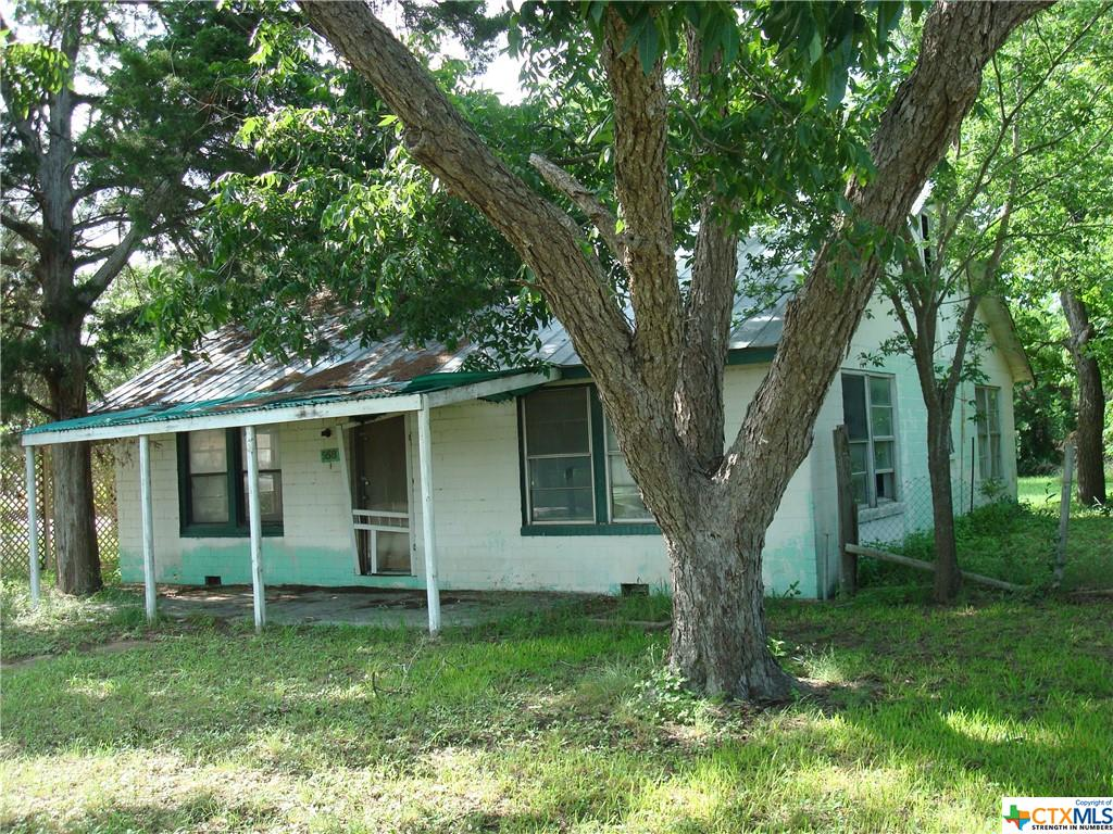 Located on W. Kingsbury St. AKA US Highway 90. Originally built as a 2 bdrm, 1 bath family home in the mid 50's, this property has been vacant for several years & is now zoned commercial.  With some work, the house can be transformed into an attractive commercial building on a tree shaded parking lot. The spacious 0.38 acre corner lot offers a high traffic count & great visibility.