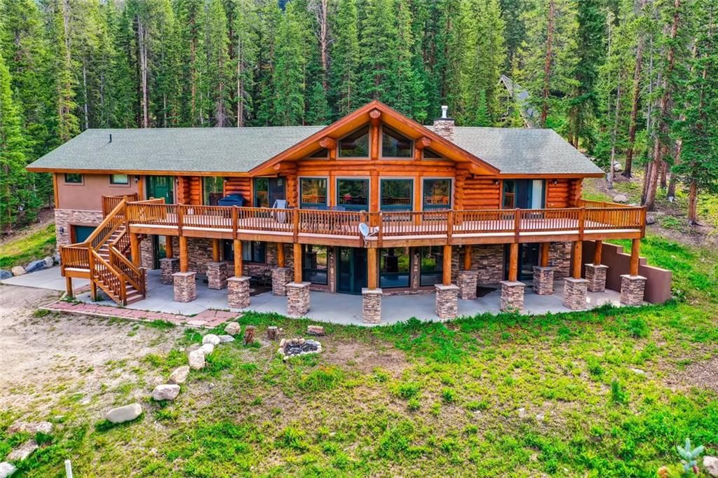Stunning log home is the perfect retreat, only minutes from Downtown Breckenridge.  Enjoy 180 degree mountain views from your wrap-around West-facing deck.  Comfortably sleeps 18, with plenty of room for the whole party! Chef's Kitchen opens to a one-of-a-kind Great Room with exposed whole log beams and big views.  Enjoy the proximity to all Breckenridge has to offer, in your private and peaceful oasis.  Office/workout bonus room.  One bedroom non-conforming with no closet. HUGE RENTAL #s!
