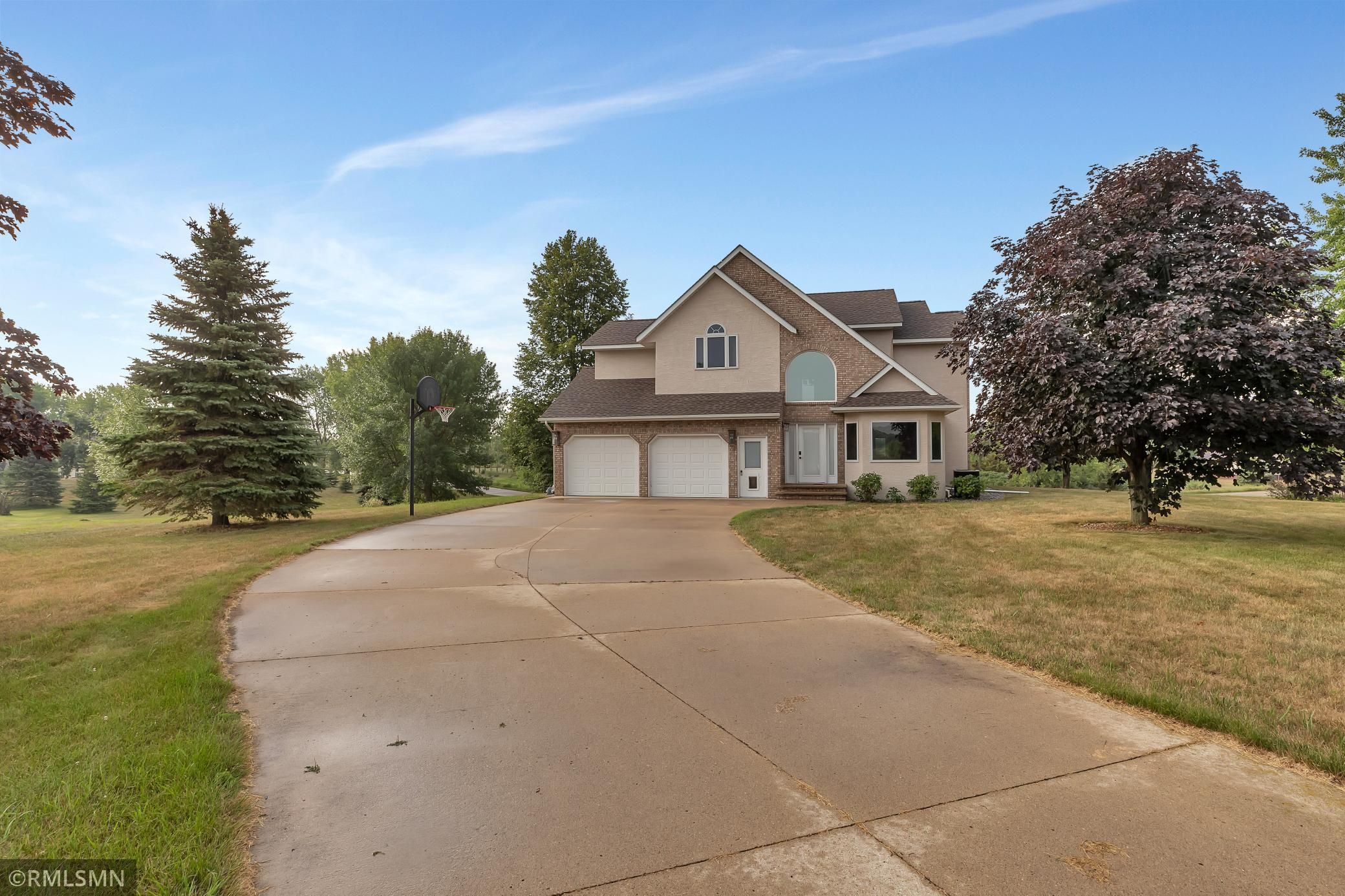 Spacious, Executive Style Home Sitting on 1.19 Acres in Oakwood Manor.  Just Minutes From Spicer, This 4 Bedroom 4 Bath Home Features Cathedral Vault Ceilings, Main Floor Office & Laundry and Spacious Kitchen with Ample Storage.  Large Master with Suite  On The Upper Level And Large Entertaining Space Can Be Found In The Walkout Basement. Large Yard, Front & Back Concrete Driveways, Large Lower Level Patio & Deck off The Main Finish Off The Outside. Many Updates Throughout Including New Roof in 2021.  Don't Miss Your Chance To See This One- Call or Message For Your Tour Today!
