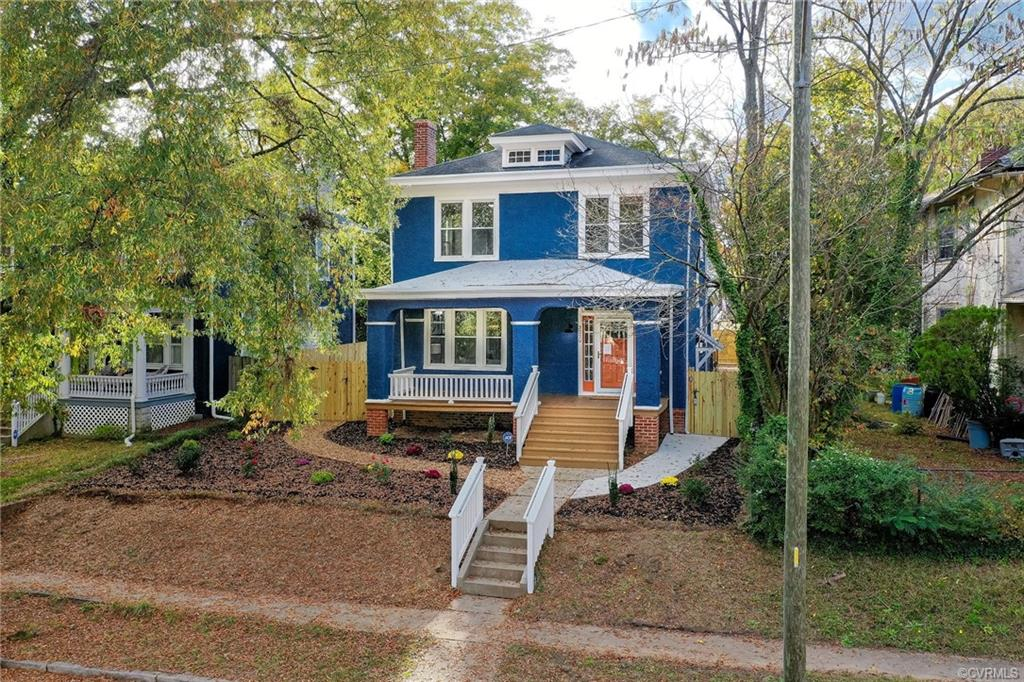 15 YEAR TAX ABATEMENT: SAVE $100's PER MONTH ON YOUR MORTGAGE! OFF-STREET PARKING in rear driveway & alley! This is a CLASSIC American Foursquare home built circa 1923 in the heart of Brookland Park! This coveted neighborhood offers sidewalks, mature trees, and rows of gorgeous historical homes! This home has been restored beautifully & meticulously, proudly boasting so much of its original 1920's character & charm! The owner consulted w/ the VA Dept of Historic Resources to preserve as much of the original historical features & layout as possible: high ceilings, architectural columns, original trim & carpentry, original French doors btwn living & dining room, original brick FP & refinished original hardwoods throughout. STUNNING kitchen w/ custom cabinetry, soft close drawers, center island, granite counters, stainless steel appliances (incl. gas range & stove hood) & tile backsplash! Unlike most older homes, this one features 3 FULL bathrooms, a primary bedroom option on 1st OR 2nd floor, & 1st floor laundry room! The exterior is a true oasis w/ a HUGE 26' deck, high end privacy fence w/ 3 gates, poured concrete sidewalks surrounding home & entire yard is beautifully landscaped!