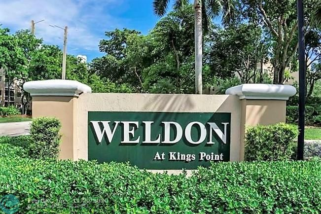Beautifully maintained waterfront unit in the gated community of Weldon at Kings Point. Patio is enclosed adding living space with sliding windows to enjoy the fresh air. Bright eat in kitchen with pass through. Newer air conditioner. Magnificent clubhouse with community center, pools, exercise area, library, card and craft rooms etc. etc. Courtesy bus with expanded routes. This condo has it all including affordability in a resort style atmosphere. Great restaurants and shopping close by.