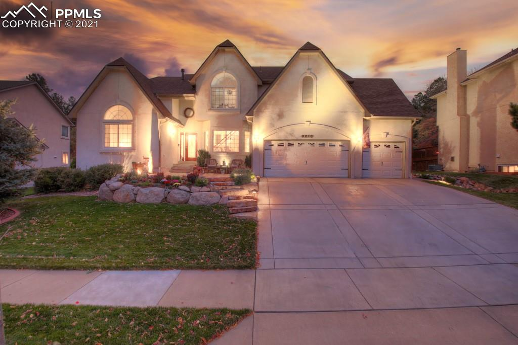 Located in highly desirable Peregrine, this recently remodeled estate includes chic modern touches with traditional class. This exceptional home is PERFECT for entertaining family and friends and is move-in ready. Abundance of natural light cascade off the walls and the 2-story double-sided fireplace which creates the warmth and cozy ambiance that radiates classic Colorado Living. Highlights of the gourmet kitchen are timeless knotty alder cabinets, granite counter tops, new touch faucet, massive island, and new cooktop. Step into the nestled backyard and enjoy the stamped concrete patio for cook outs or relaxation with the deer and other friendly neighborhood wildlife. The back wall of windows with vaulted ceilings allows you to enjoy all four seasons inside the comfort of your home. Lower level features a large bedroom, bathroom, family room with two-sided fireplace and recreation area which includes a pool table and bar. Pool table and bar are inclusive with the home purchase (bar, cabinet behind bar, and chairs). Bar area is a flex space and can be used for a workout room or even converted into a 6th bedroom. The upper level accommodates two bedrooms that share a Jack and Jill bathroom and one bedroom that has its own private bath. The AMAZING main level master amenities includes its own double-sided fireplace into the redesigned, sprawling master bathroom en suite. Large shower, modern stand alone tub, his and hers sinks, and spacious walk-in closet are a few of our favorite things. Additional features to include wainscotting, new paint, new and refinished hardwood floors, tile floors, lighting (chandelier, canned), AC, two 50 gal water heaters, water feature in the front landscaping, 8x10 shed, new carpet and many more! List of home improvements are attached to MLS. Furniture is negotiable, but not included with the sale. Come make this extraordinary house YOUR HOME!!