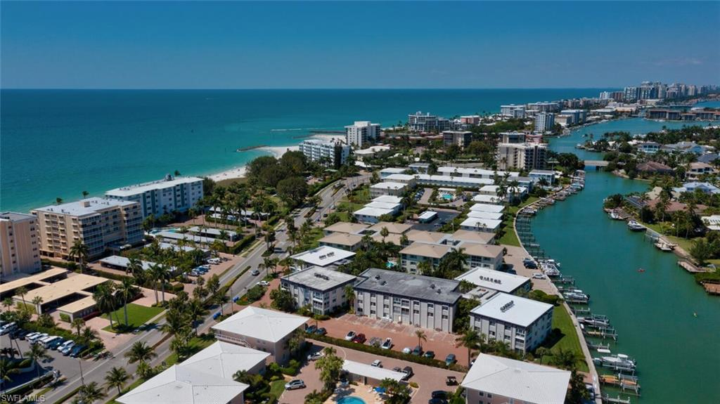 This well maintained 2 bed/ 2 bath condo is located on prestigious Gulf Shore Blvd, right across the street from Moorings Beach access, and overlooks a tropical landscaped pool area with a lovely glimpse of the bay! La Villa Riviera provides its residents with a friendly atmosphere and an abundance of lush landscaping- It is a fantastic opportunity to live steps from the beach at a great price! Amenities include a beautiful pool with grilling area, fitness room, a large breezeway overlooking the pool where many social events are held, sizable storage closets and private boat docks. Condo features an open floor plan with an abundance of natural light, tile flooring and crown molding throughout, custom kitchen cabinets, newer HVAC and water heater, coffered sealing detail and plenty of storage. ALL of this, just minutes from 5th Ave South's fine dining and shopping!